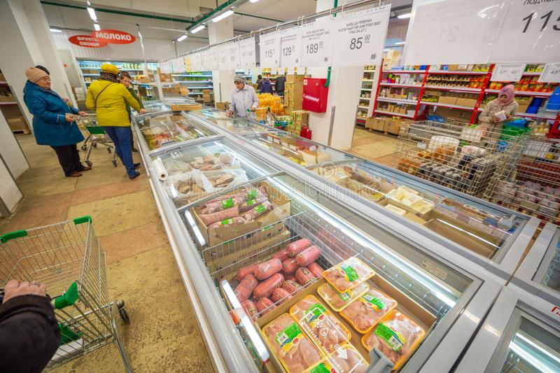 Samara, November 2018: interior of a grocery store with shop windows and freezers. Text in Russian: milk, fruit, vegetables. Russia, Samara, November 2018 royalty free stock image