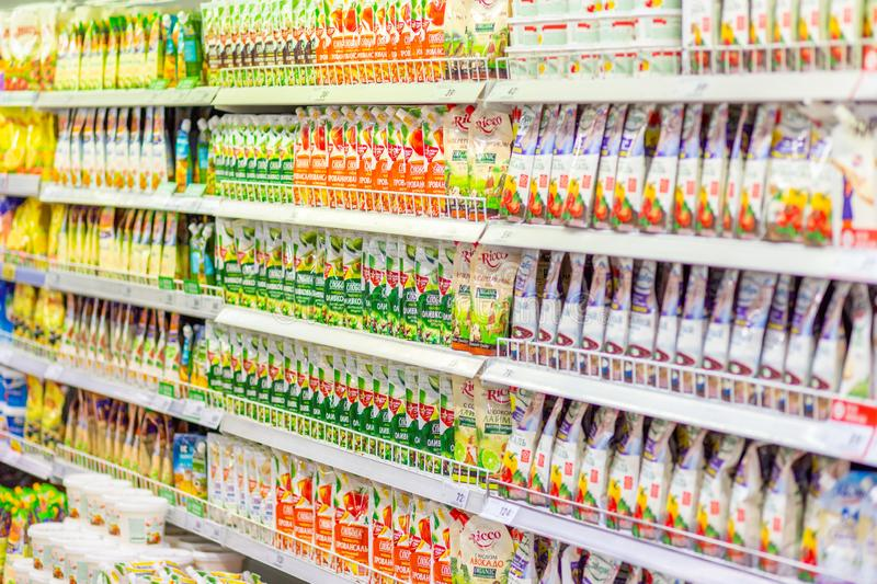 Samara, November 2018: a large selection of different mayonnaise in the supermarket. Text in Russian: Makheev, Sloboda, olive, add stock photography