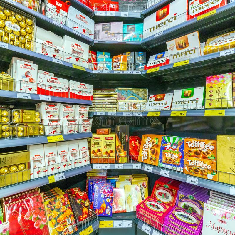 Store shelves with different kinds of chocolate in a supermarket. stock photo
