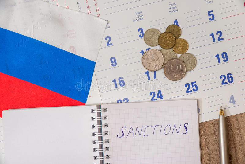 Russia sanctions. Calendar, flag and pen stock photography