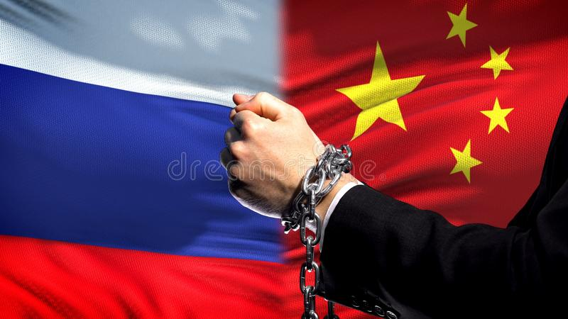 Russia sanctions China, chained arms, political or economic conflict, trade ban royalty free stock photo