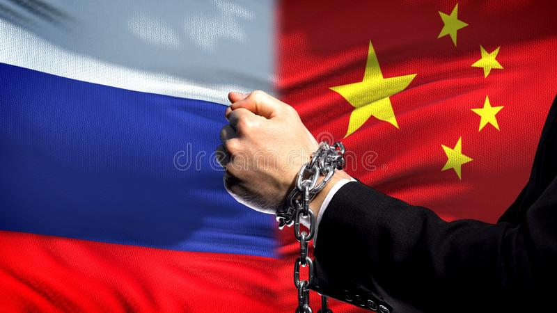 Russia sanctions China, chained arms, political or economic conflict, trade ban stock photo