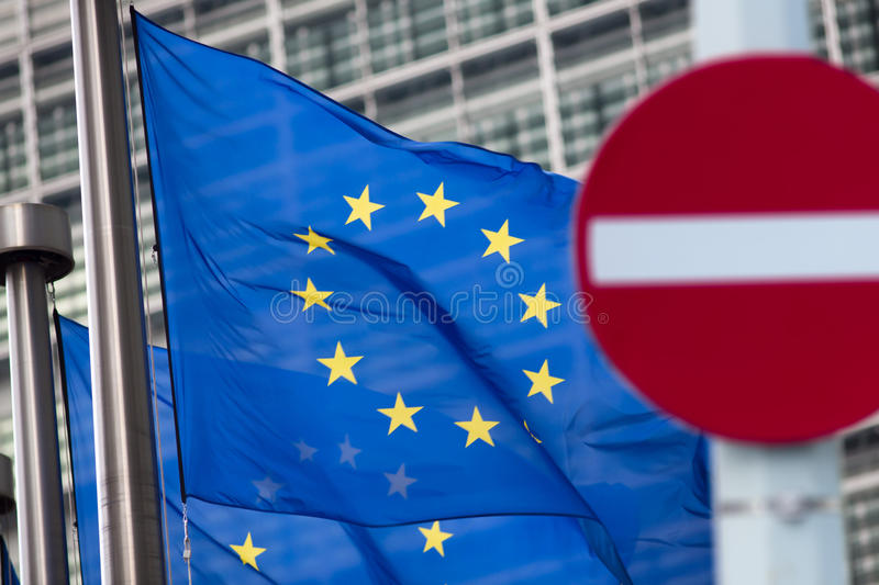 Russia sanctions. 'No entry' sign in front of. 'No entry' sign in front of European comission flags royalty free stock photo