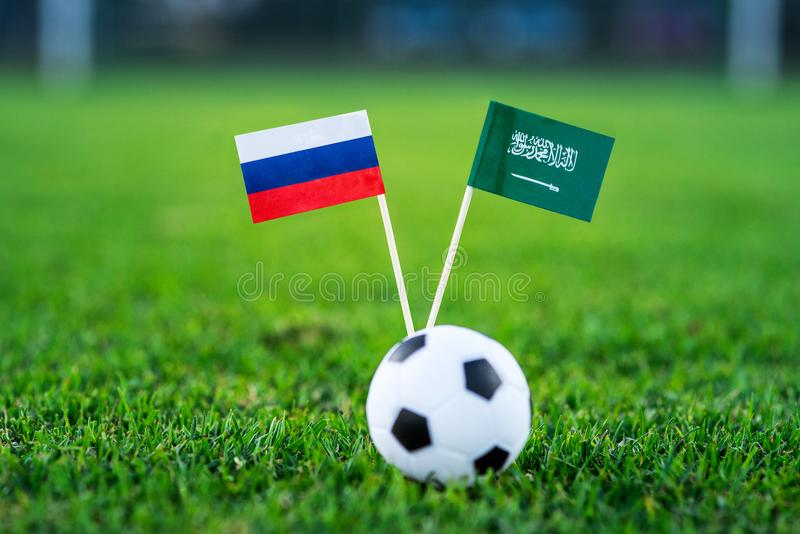 Russia - Saudi Arabia, Group A, Thursday, 14. June, Football, 2018, National Flags on green grass, white football ball on ground. royalty free stock photos