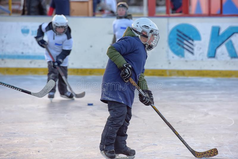 Children with hockey sticks playing hockey at the festival. Russia, Severodvinsk 27,11,2016 Children with hockey sticks playing hockey at the festival `Hockey stock images