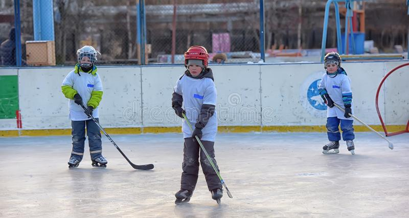 Children with hockey sticks playing hockey at the festival. Russia, Severodvinsk 27,11,2016 Children with hockey sticks playing hockey at the festival `Hockey royalty free stock photo