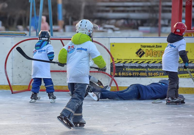Children with hockey sticks playing hockey at the festival. Russia, Severodvinsk 27,11,2016 Children with hockey sticks playing hockey at the festival `Hockey stock photography