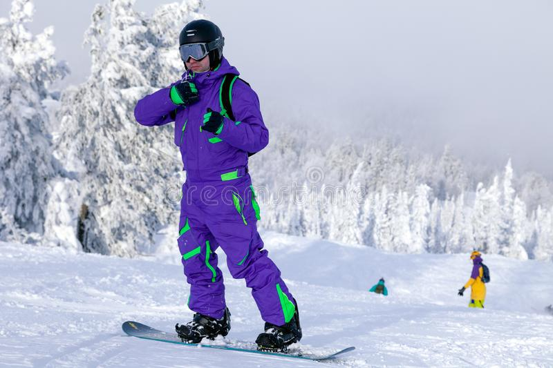Russia, Sheregesh 2018.11.78 Professional snowboarder in bright royalty free stock photography