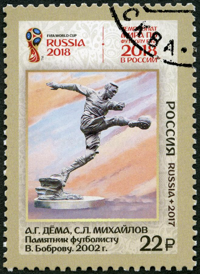 RUSSIA - 2017: shows Football Player monument, series Football in Art, 2018 Football World Cup Russia. RUSSIA - CIRCA 2017: A stamp printed in Russia shows stock photo