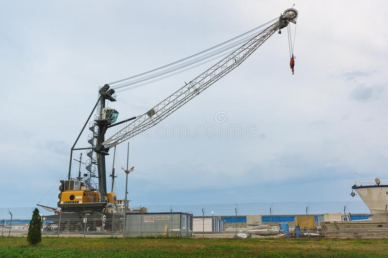 Liebherr Mobile port crane in Imeretinsky cargo seaport at the mouth of the Mzymta river stock photo