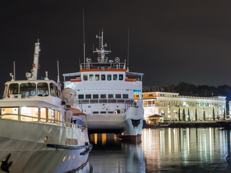 Russia, Sochi 07.22.2019. Photo of the back of a large white ship standing at the pier at night. Russia, Sochi 07.22.2019. Photo of the back of large white ship royalty free stock photo