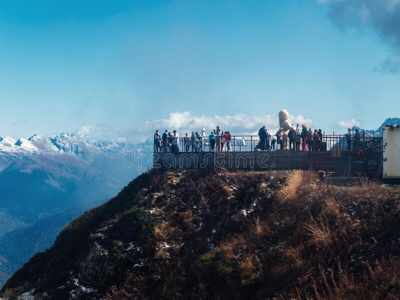 Russia, Sochi 03.10.2019. View of the observation deck with people on top of a mountain with blue sky stock images