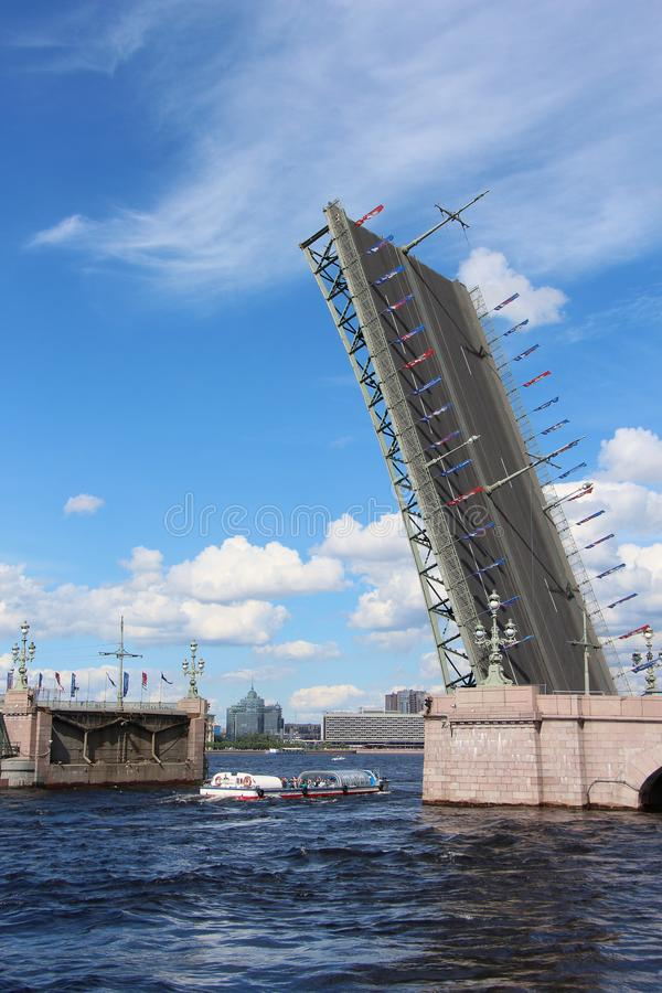 Russia, St. Petersburg, the divorced Trinity Bridge. With a walking cruise underneath it stock images