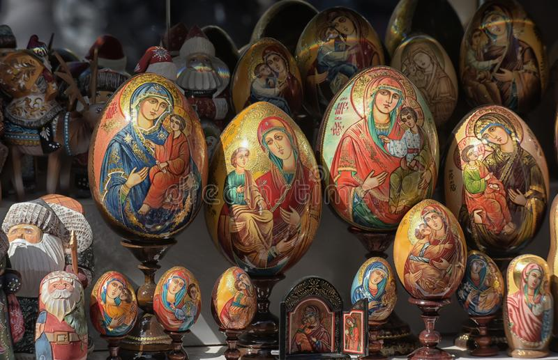 Easter eggs painted with Madonnas with a baby at a souvenir shop royalty free stock photo