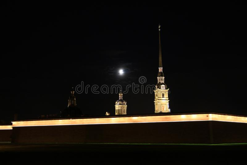 Full moon above the fortress. Russia, St. Petersburg, the full moon above the Peter and Paul Fortress royalty free stock photography
