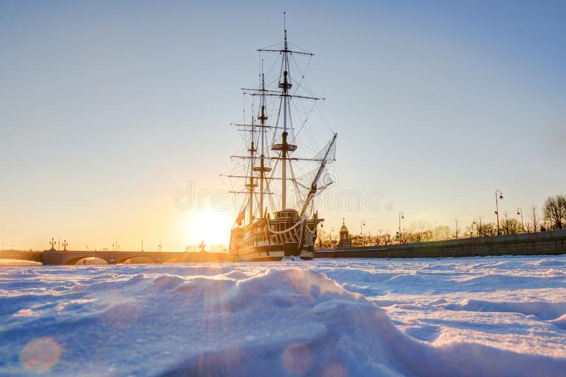 Russia, St. Petersburg, March 4, 2018: Frigate `Grace` on a frost, Neva river, sunset royalty free stock photo