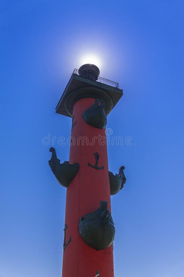 St. Petersburg Russia Rostral column solar glow against a blue sky stock image