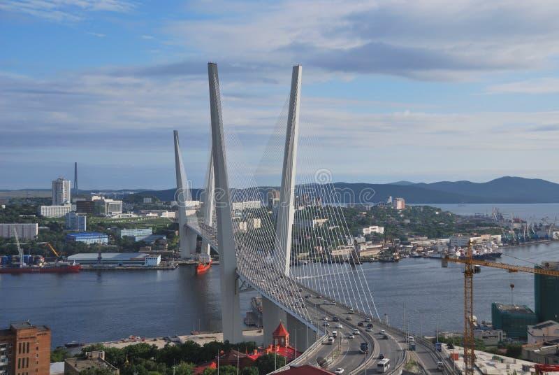 Russia. Sun Vladivostok, Golden bridge. stock photos