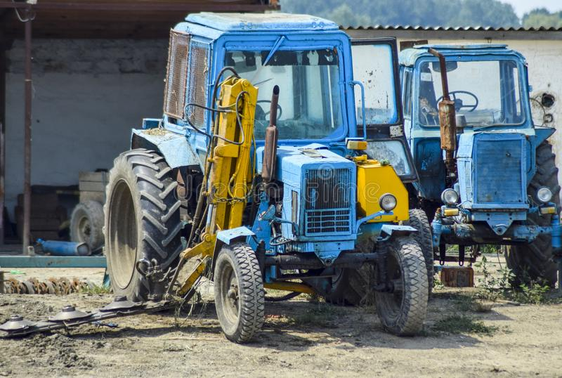 Tractor, standing in a row. Agricultural machinery. Russia, Temryuk - 15 July 2015: Tractor, standing in a row. Agricultural machinery. Parking of agricultural stock images