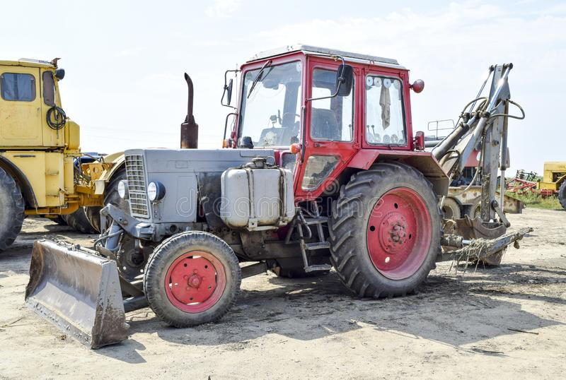 Tractor, standing in a row. Agricultural machinery. Russia, Temryuk - 15 July 2015: Tractor, standing in a row. Agricultural machinery. Parking of agricultural stock photography