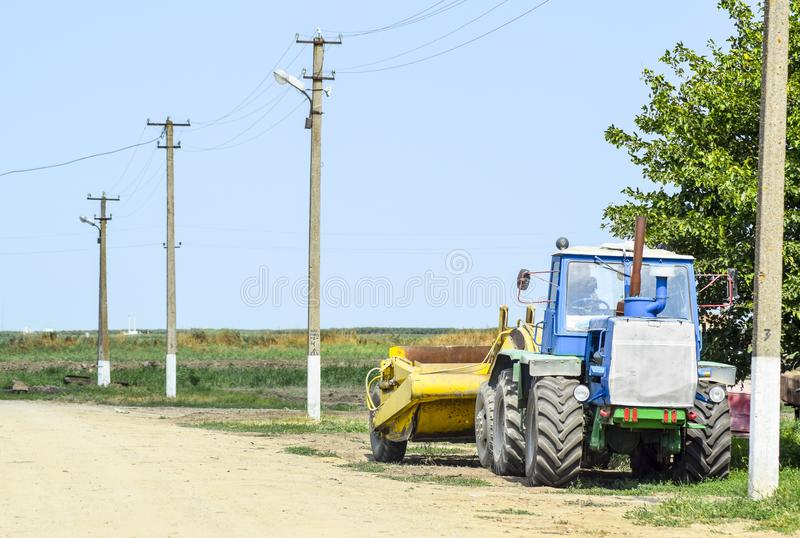 Tractor, standing in a row. Agricultural machinery. Russia, Temryuk - 15 July 2015: Tractor, standing in a row. Agricultural machinery. Parking of agricultural royalty free stock photos