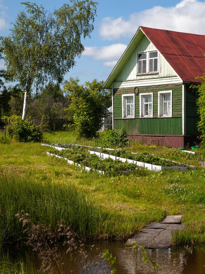 Old wooden house in rural vegetable garden royalty free stock photos