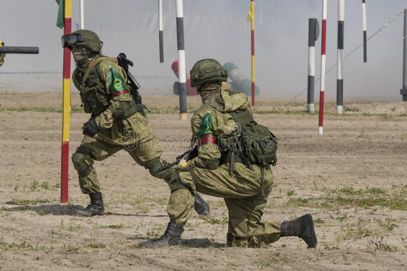 Russia. Tyumen, August 11, 2019: international Army Games. Final `Safe route` Military perform combat mission on the training fiel stock photography