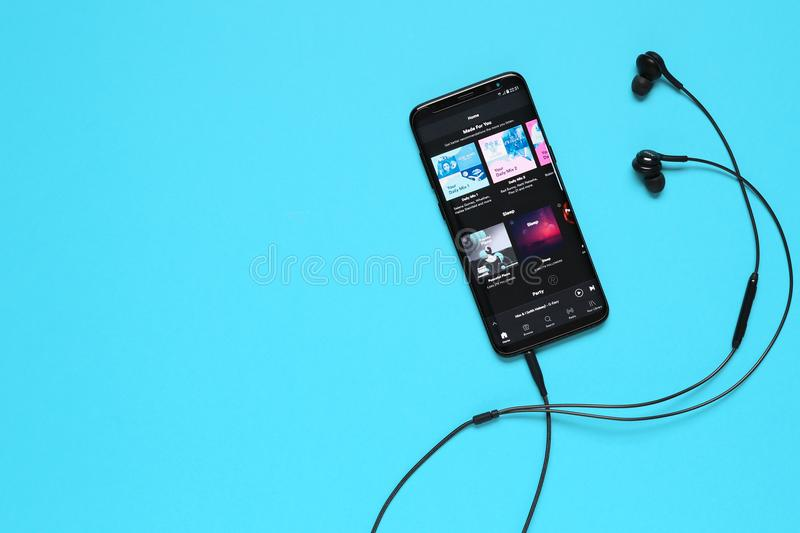 RUSSIA, Tyumen - February 10, 2018: Spotify application on mobile device. Flat lay. royalty free stock photos