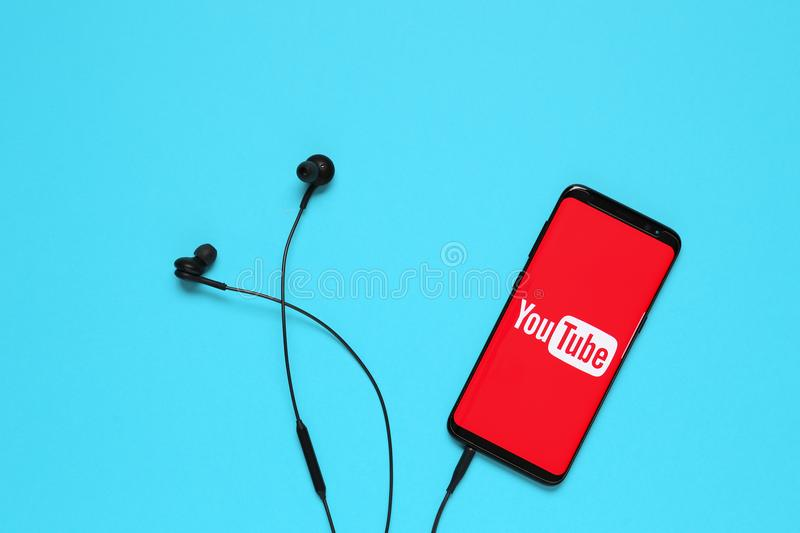 RUSSIA, Tyumen - February 10, 2018: Youtube application on mobile device. Flat lay. royalty free stock photography