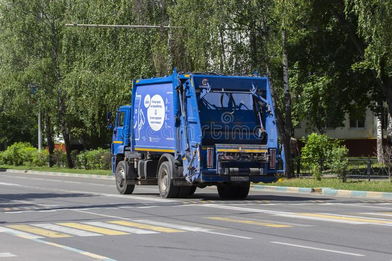 02-07-2019, Russia, Vidnoe. Blue truck for separate garbage collection, waste sorting and recycling. Blue garbage truck on a city stock photo