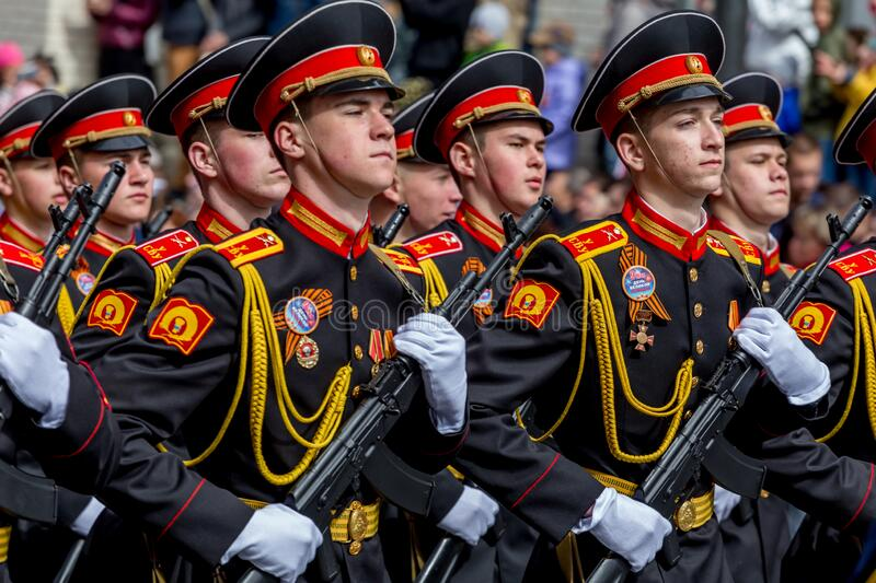 Russia, Vladivostok, 05/09/2018. Graduates of Suvorov Military School in dress uniform with machine guns on parade on annual stock photo