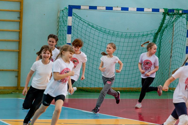 Kids training before play handball indoor. Sports and physical activity. Training and sports for children. Russia, Vladivostok, 04/28/2018. Kids training before stock photography