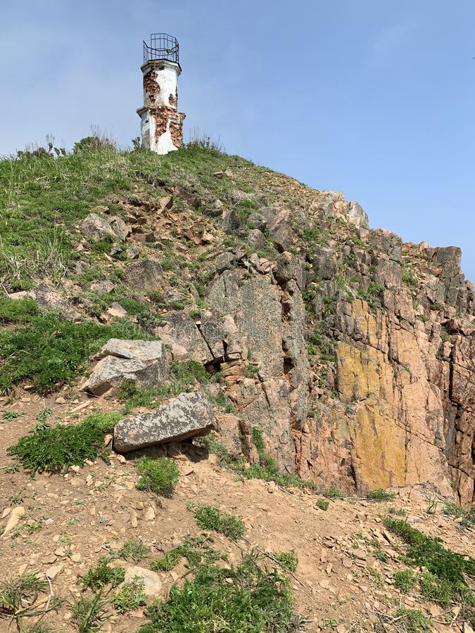 Russia, Vladivostok, lighthouse on the island of Shkot in June.  royalty free stock photo