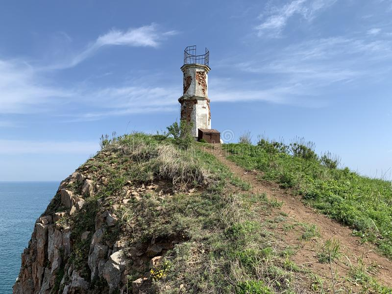 Russia, Vladivostok, lighthouse on the island of Shkot in may.  royalty free stock photography