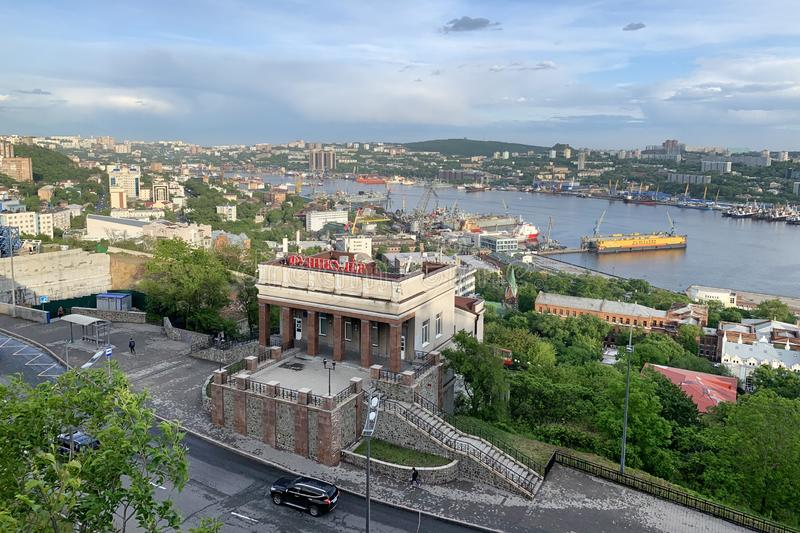 Russia, Vladivostok, May, 31, 2019. Golden horn Bay and the upper station of the funicular in cloudy weather in Vladivostok royalty free stock photography