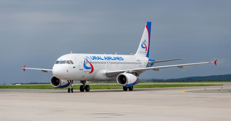 Passenger airplane Airbus A320 of Ural Airlines on airfield royalty free stock photography