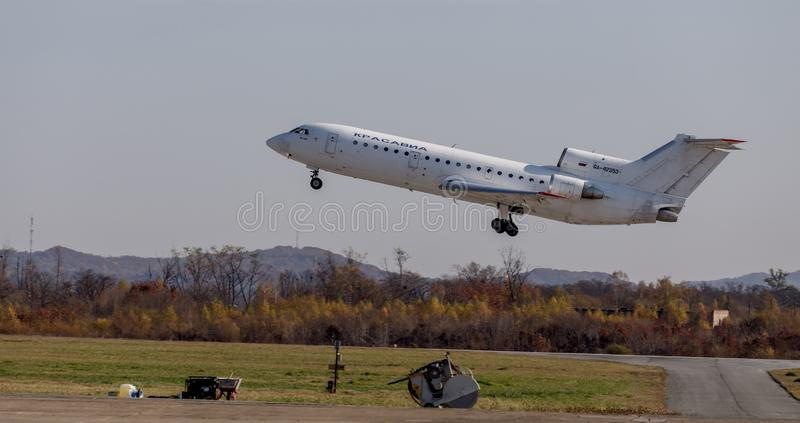 Passenger jet aircraft Yakovlev Yak-42 NATO reporting name: Clobber of KrasAvia Airlines company takes off. Airplane`s fuselage. Russia, Vladivostok, 10/13/2017 stock photos
