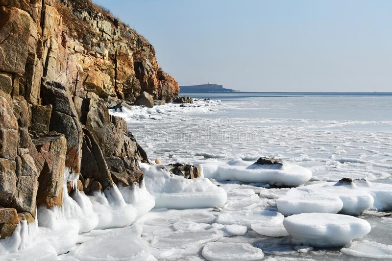 Russia, Vladivostok, Russkiy island. The rocky coast of bay New Dzhigit in winter royalty free stock photography
