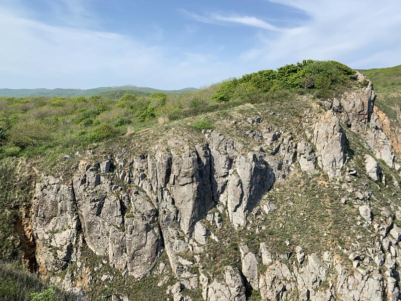 Russia, Vladivostok. The topography of the island of Shkot in the archipelago of the Empress Eugenie in sunny spring day.  stock photos