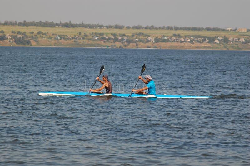 Swim kayaking. Swimming competition kayak. Russia, Volgodonsk - June 10, 2015 Swim kayaking Swimming competition kayak stock photography