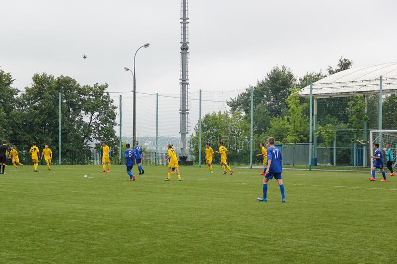 Football game. Russia, Volgodonsk - may 17, 2015: Football game. Training matches junior teams and fans stock photography