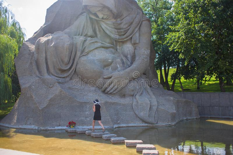 Russia, Volgograd, on July 23, 2019: the girl goes to honor to a monument The grieving mother on Mamayev Kurgan stock photography