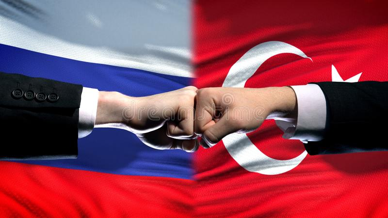 Russia vs Turkey conflict, international relations, fists on flag background. Stock photo stock photos