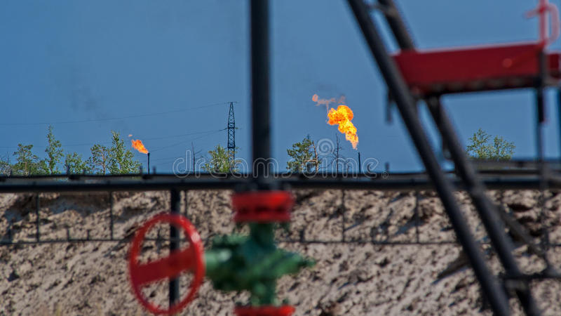 Russia. Western Siberia. In the oil fields burning of associated gas. Oil production. Gas flare stock photo