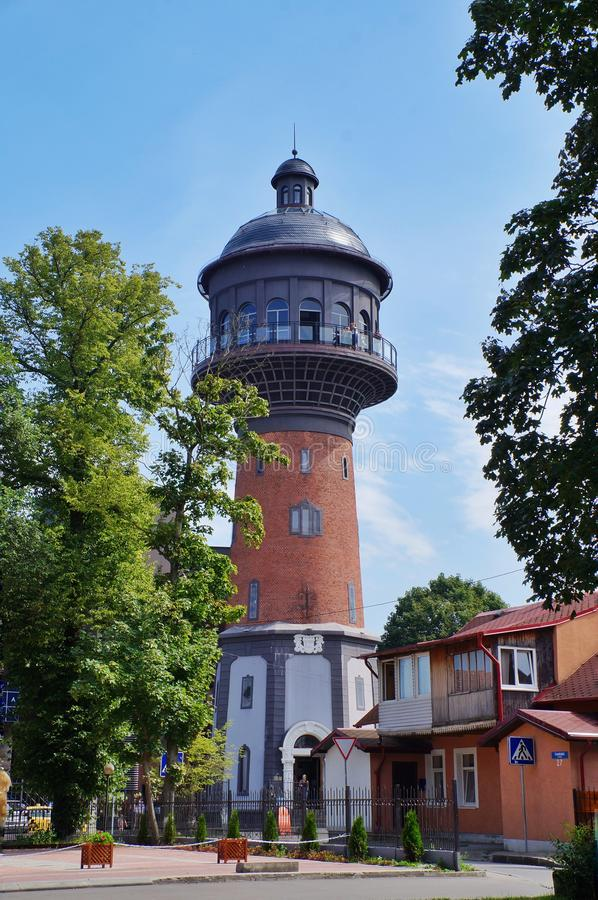 Russia, Zelenogradsk, Kaliningrad region August 10, 2017. old water tower, made of red brick, with a roof of dark metal stock images