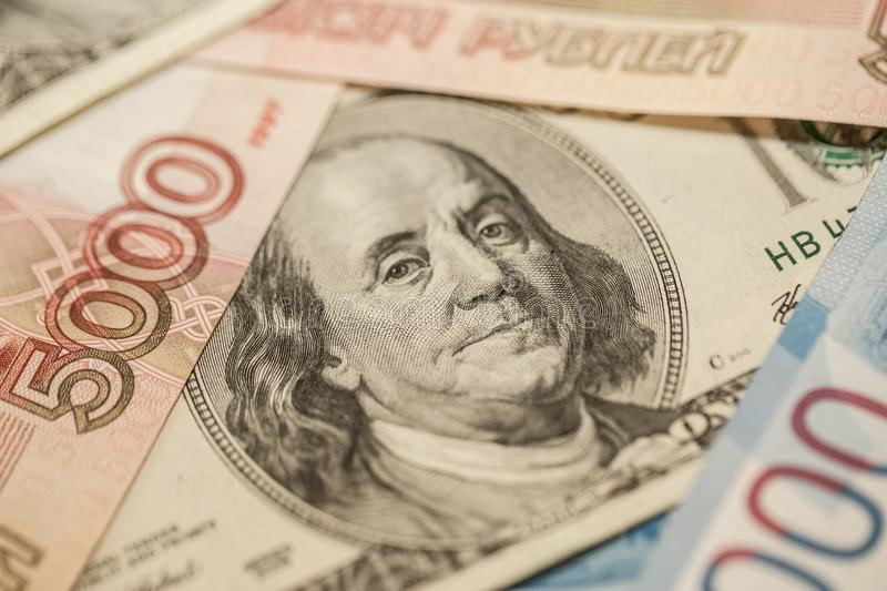 Russian and American banknotes. Fresh exchange rates. Economy of the two countries. royalty free stock photography