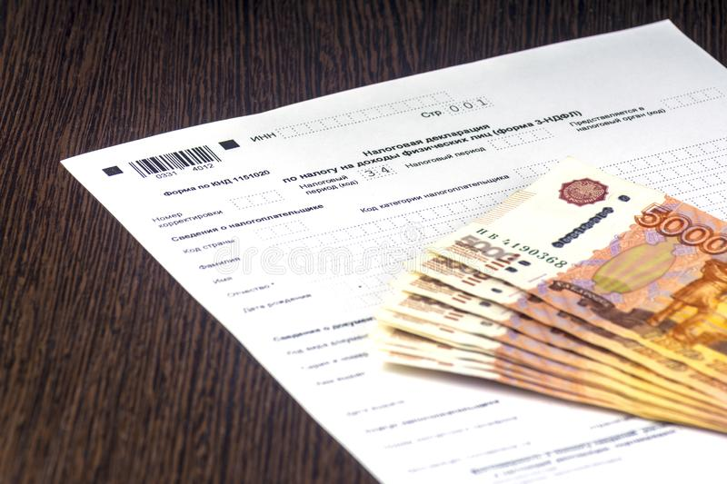 Russian annual tax Declaration of taxes of individuals. The Form 3-NDFL. A few Russian notes are on the sheet of the Declaration. Russian annual tax Declaration stock photography