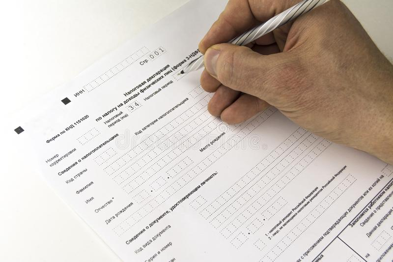 Russian annual tax Declaration of taxes of individuals. The Form 3-NDFL. Hand writing the Declaration.  royalty free stock photos