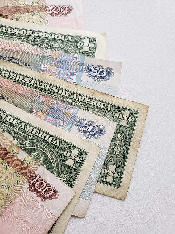 Russian banknotes and american one dollar bills on white background royalty free stock photography