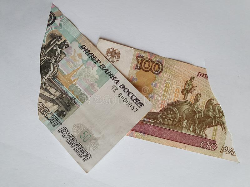 Russian banknotes of different denominations on the broken sheet of paper. Commerce, exchange, trade, trading, value, buy, sell, profit, price, rate, cash royalty free stock image